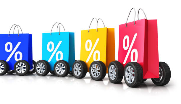 Color paper shopping bags with percent symbols and car wheels Creative abstract commercial business retail sale and online shopping discount offer and free shipping and delivery concept: 3D render illustration of train from the group of color paper shopping bags with percent text signs or symbols and car wheels isolated on white background with reflection effect discount store stock pictures, royalty-free photos & images