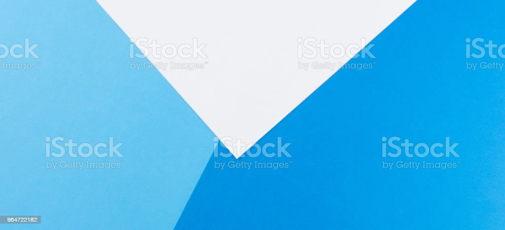 Color papers composition background with white and blue tones royalty-free stock photo