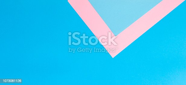 857920492istockphoto Color papers geometry flat composition background with pink and blue tones 1073081126