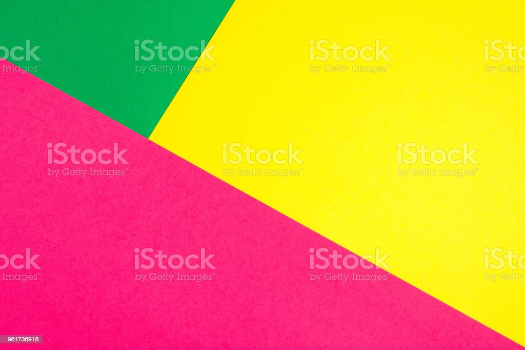 Color papers geometry flat composition background with yellow, green, and pink tones royalty-free stock photo