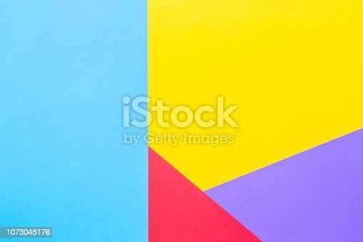 857920492istockphoto Color papers geometry flat composition background with yellow red blue and purple tones 1073045176
