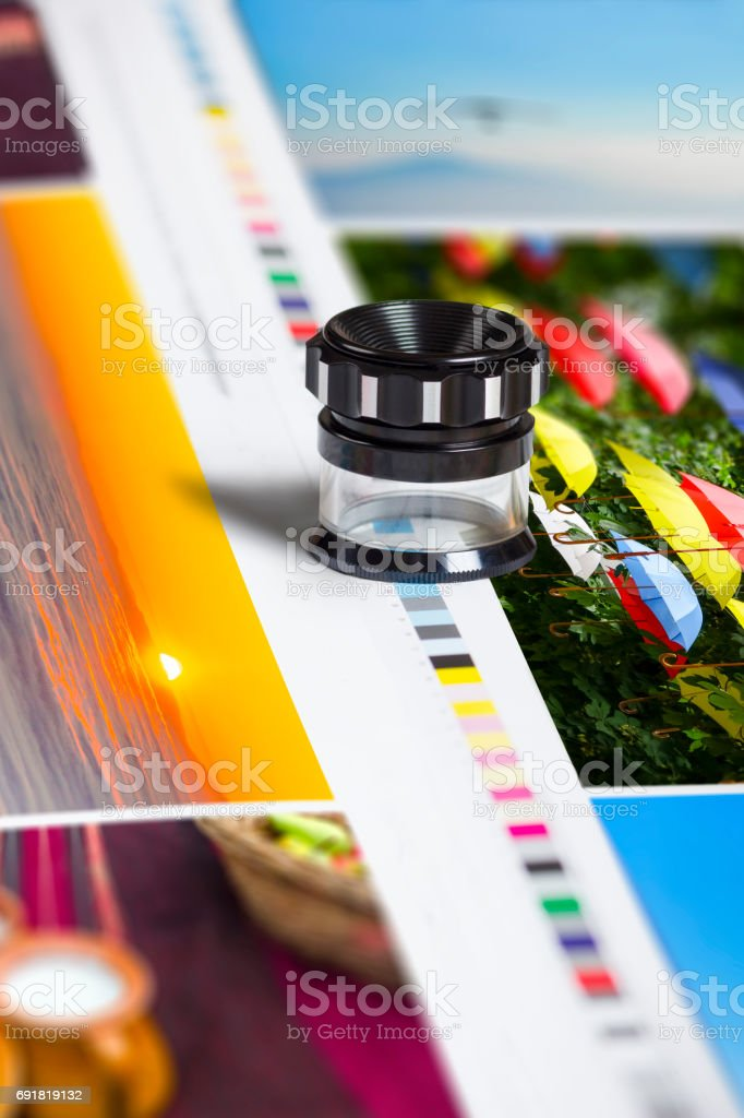 Color patch bars on offset print sheet and magnification loupe stock photo