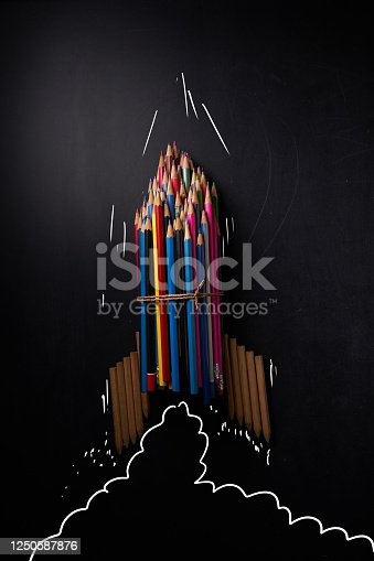 Launch of an abstract rocket bundled with colored pencils