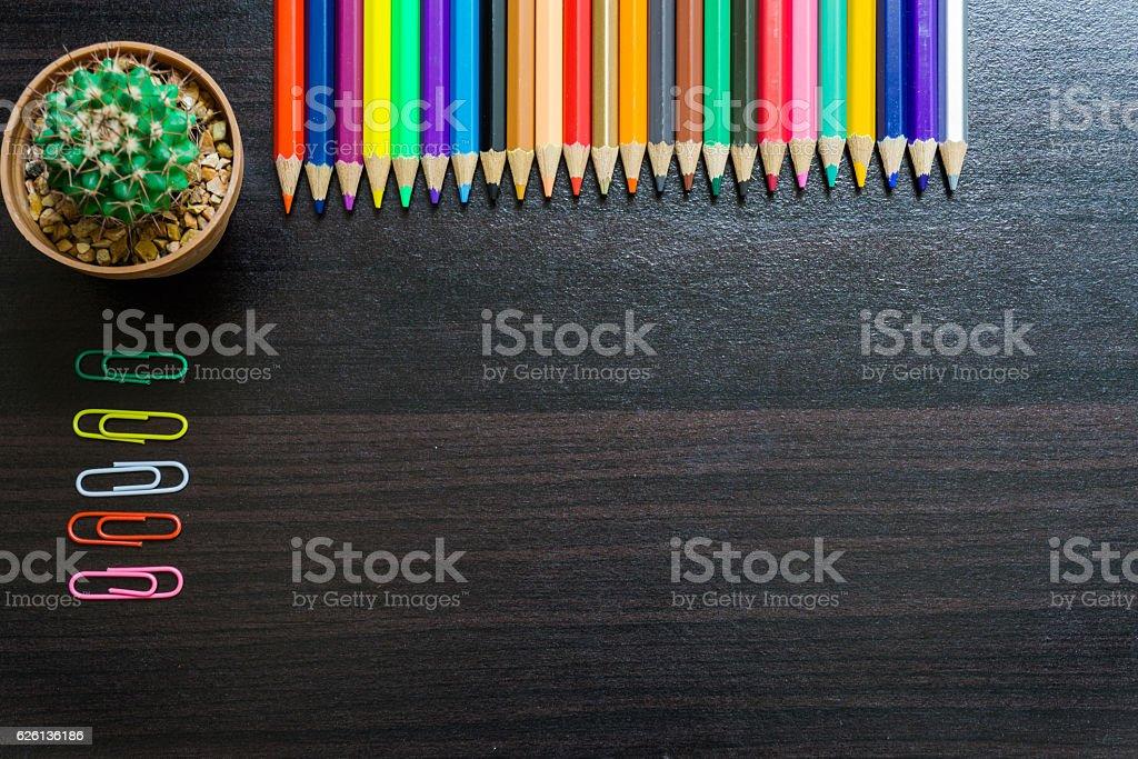 color pencil on desk stock photo
