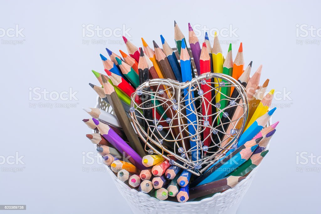 Color Pencils and heart shaped metal wire cage zbiór zdjęć royalty-free