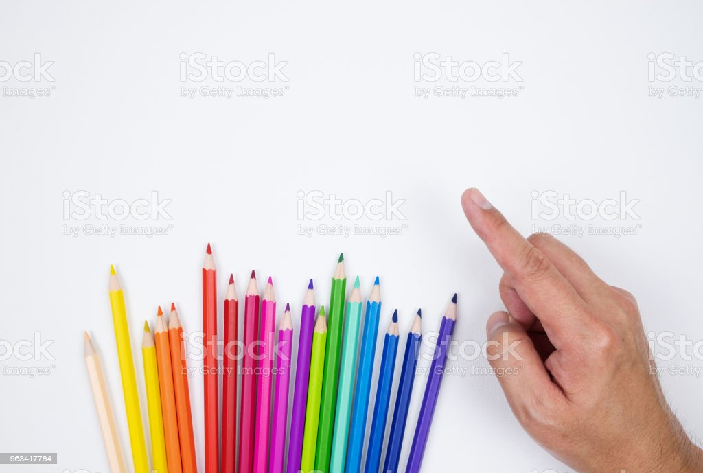 Color pencils and man hand pointing isolated fabric on white fabric canvas background - Zbiór zdjęć royalty-free (Aranżacja)