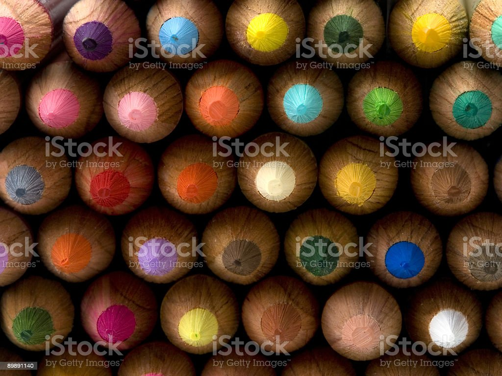 Color pencils arranged neatly in rows stock photo