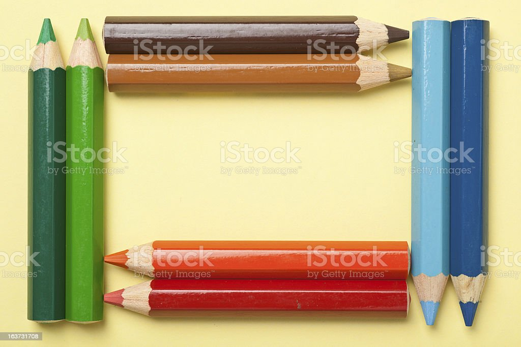 Color pencils forming a rectangle frame royalty-free stock photo