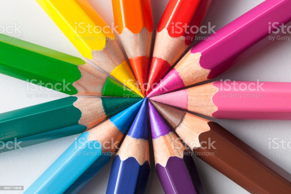 Color pencils in circle composition stock photo