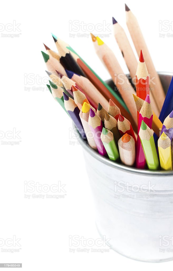 Color pencils in pencil holders isolated on white background, royalty-free stock photo