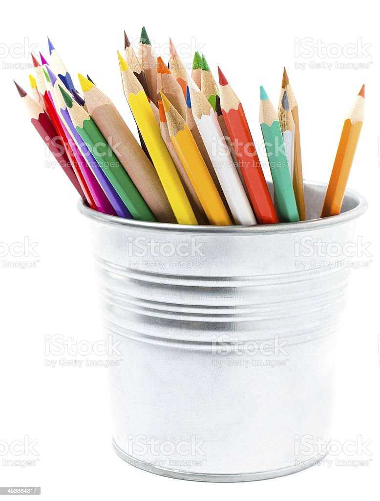 Color pencils in pencil holders isolated on white background, stock photo