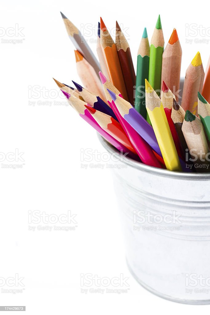 Color pencils in tin can or pencil  holders royalty-free stock photo