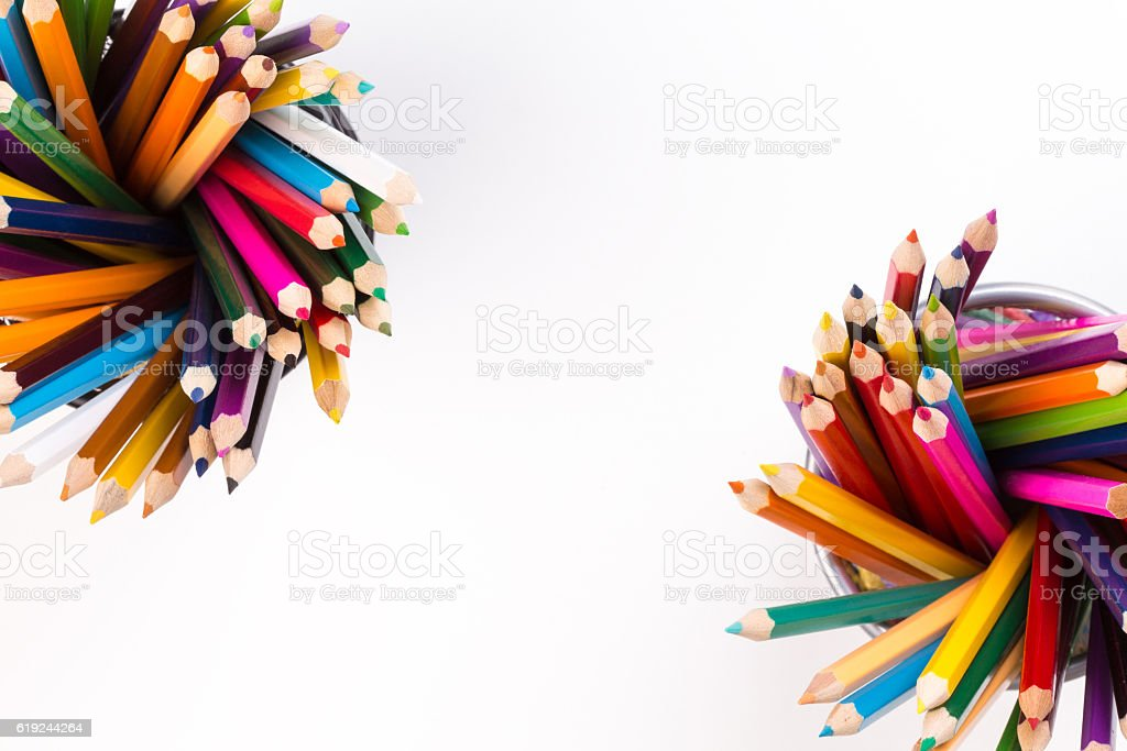 Color pencils in two office bins in different corners stock photo