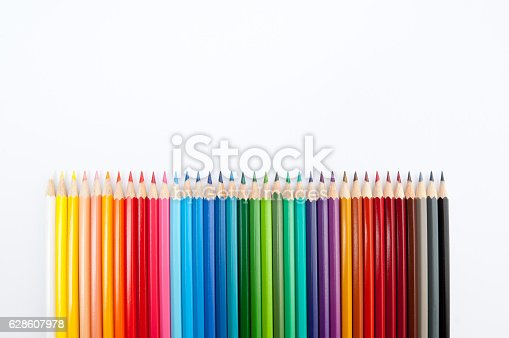 Pattern of color pencils isolated on white background close up