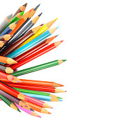 Color pencils isolated on white background.Close up. Free space for text.