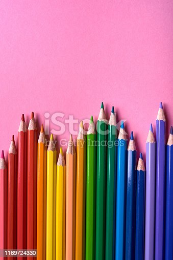 1137970382 istock photo Color pencils on pink pastel background, close up. Set of colorful pencils, copy space. Crayons. Top view, flat lay. Back to school, college concept. Abstract background 1169724330