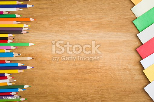 istock Color pencils on the wooden table. Art concept. Top view. Empty place for a text or drawing on the background. 843566026