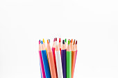 Colorful photograph of some new wooden colored pencils for drawing and painting on isolated white background