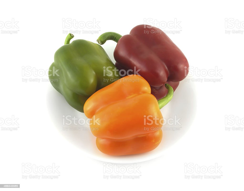 Color peppers on plate isolated close up royalty-free stock photo