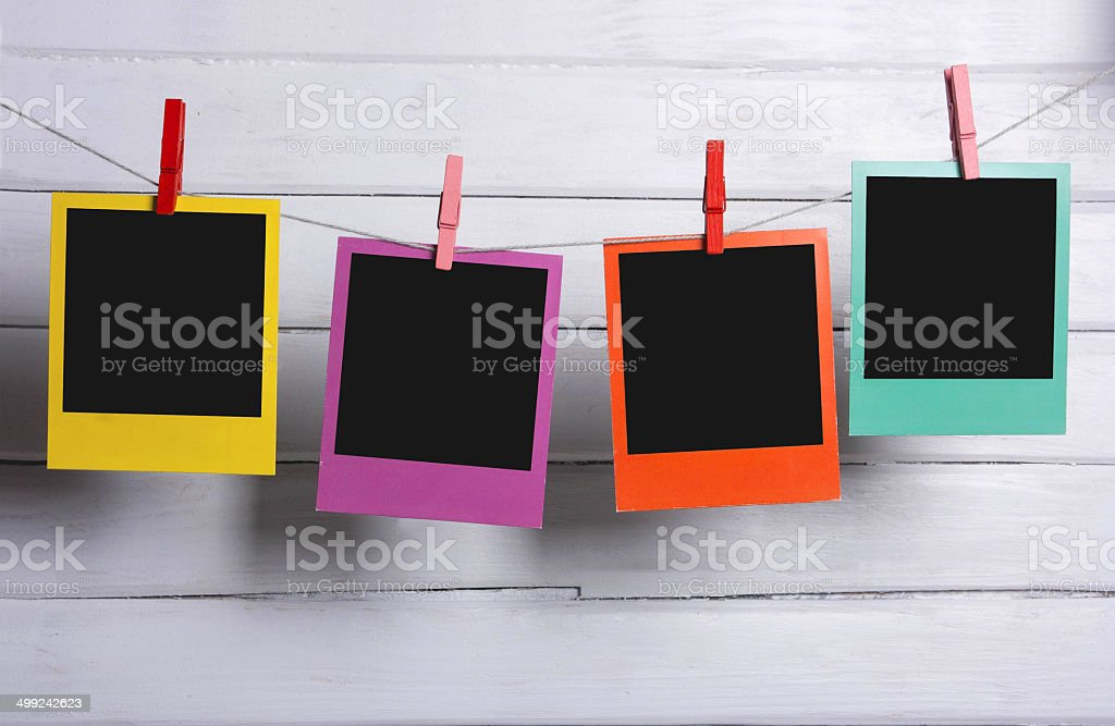 Color photo frames on a clothesline stock photo