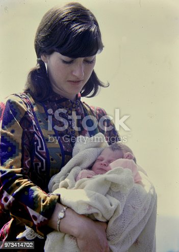 Self portrait by the photographer of herself with her newborn daughter