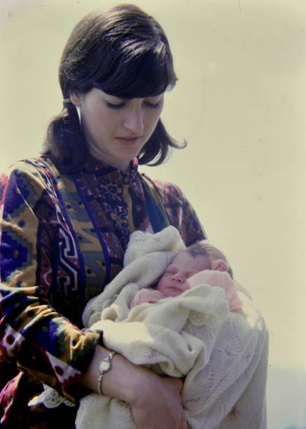 color photograph of mother and child - archiwalny zdjęcia i obrazy z banku zdjęć