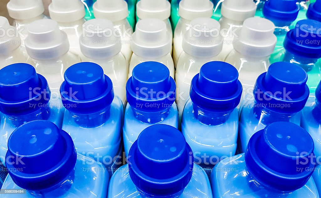 Color plastic bottles in a row. – Foto