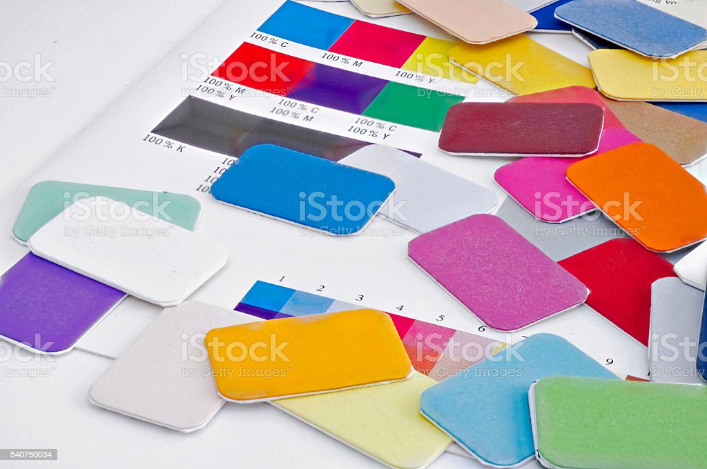Color plates of paper in many different bright colors. stock photo