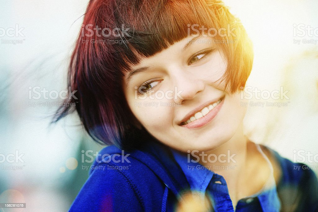 Color portrait of a charming and laughing girl stock photo