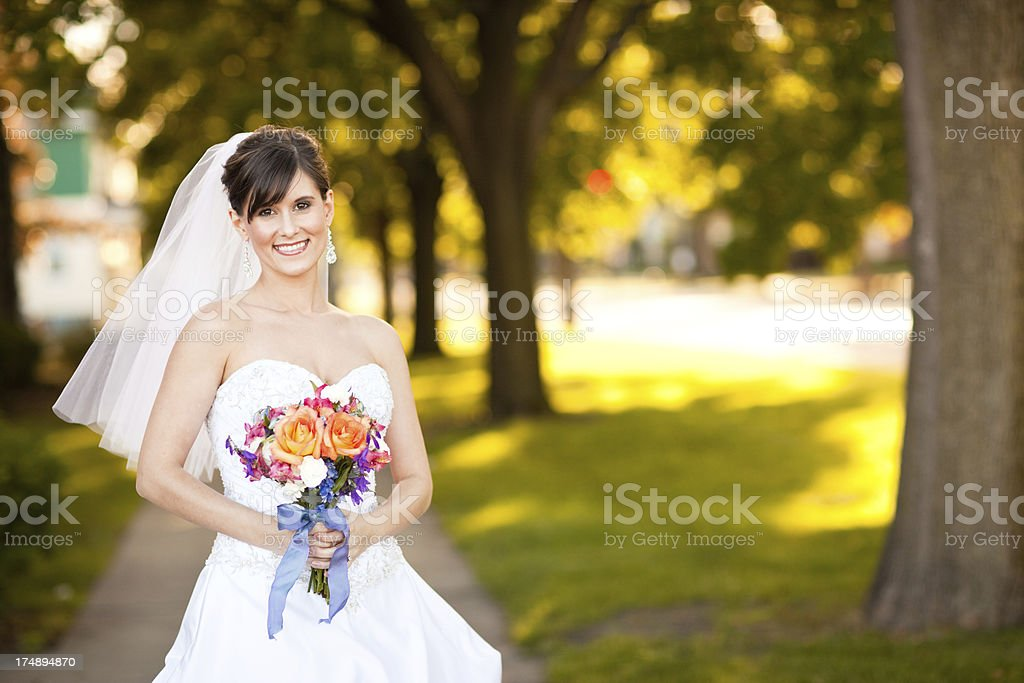 Color Portrait of Beautiful, Smiling Bride Standing Outside royalty-free stock photo