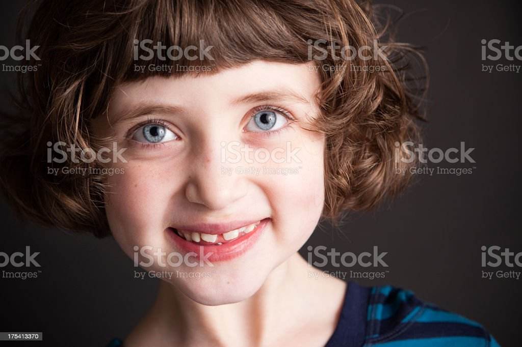 Color Portrait of Cute Little Girl, With Black Background stock photo