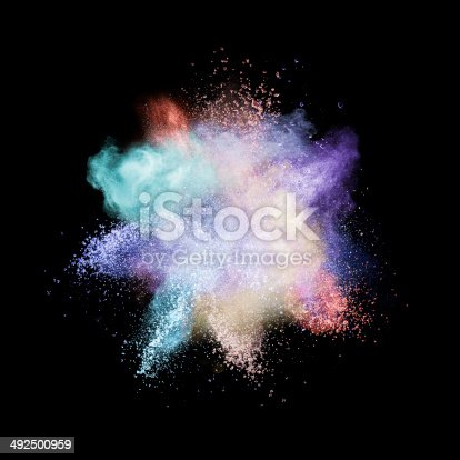 istock Color powder explosion isolated on black 492500959