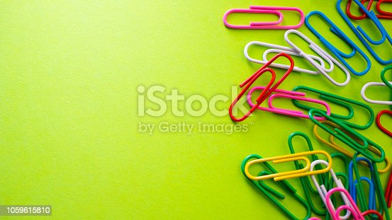 istock Color push pins on green background for copy space 1059615810