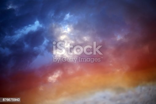 istock Color rainbow sky, blue clouds. Sunset sky with colorful rainbow 876675940