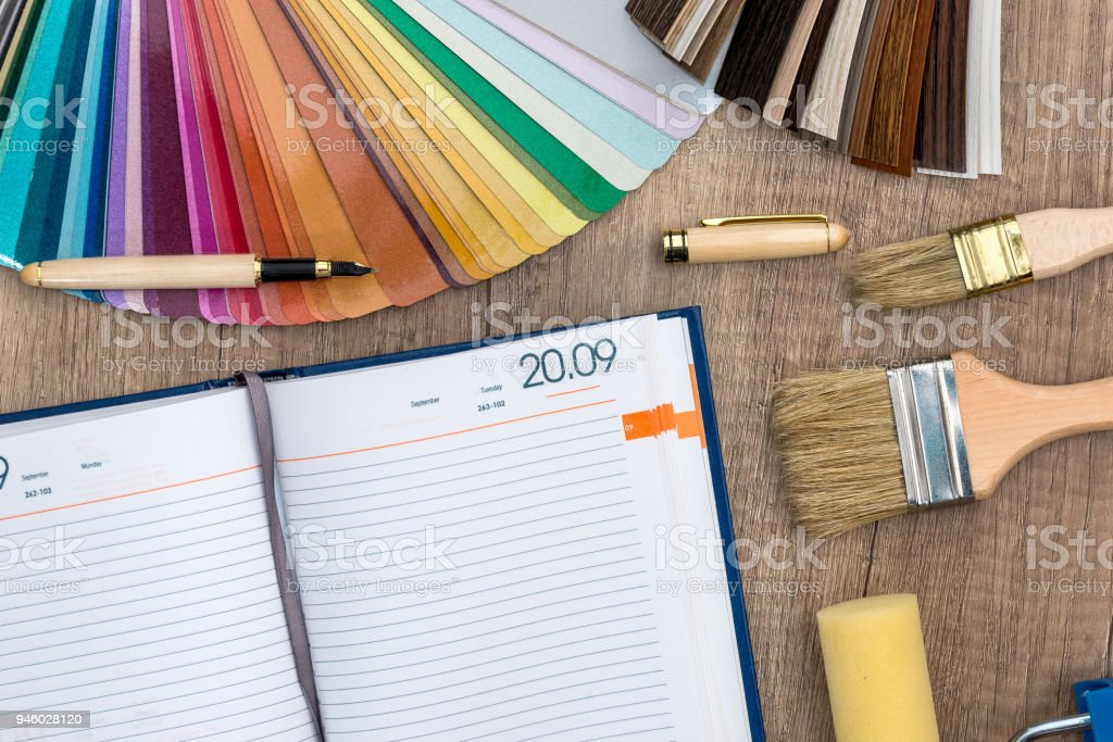 color sample with brush , notebook and roller . stock photo