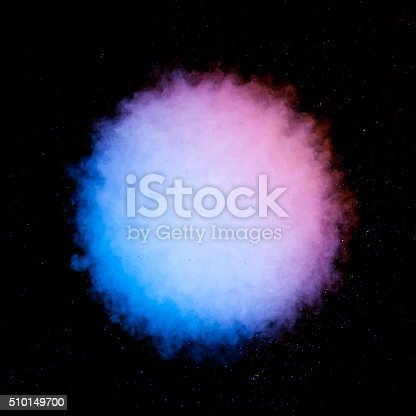 istock Color smoke explosion isolated on black 510149700