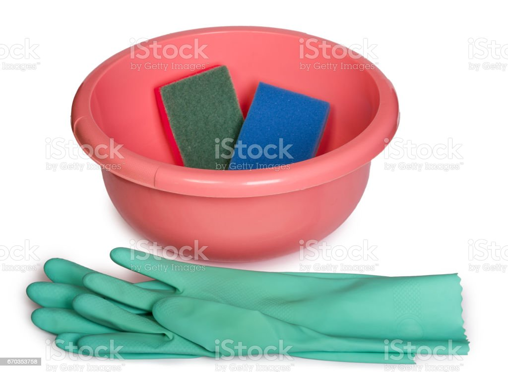 Color sponges for dish washing rubber protective gloves and plastic  bowl on white background. Cleaning concept. stock photo