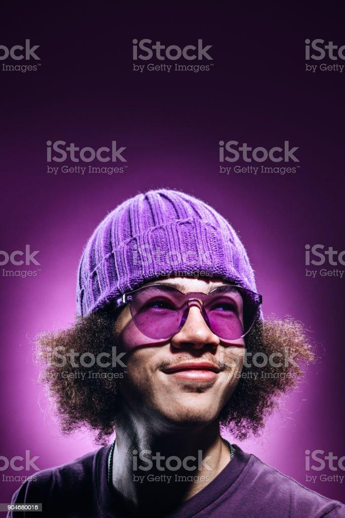 Color Surge Purple Portrait of Young Man stock photo