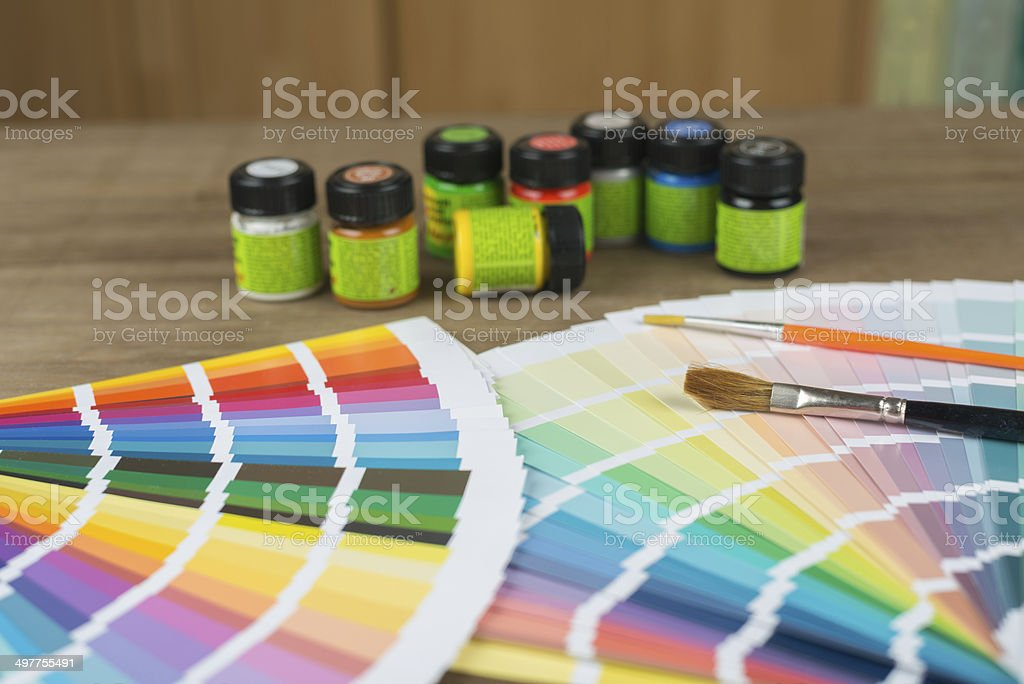 color swatch, brushes and bottles stock photo