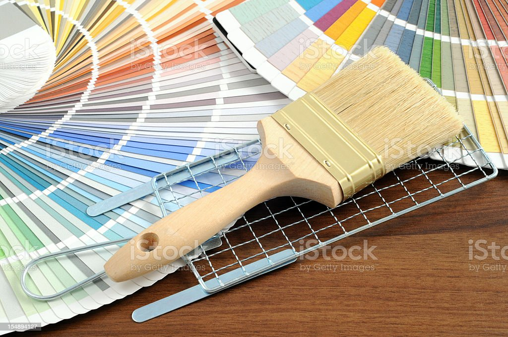 Color Swatch for home improvement with paintbrush and colander stock photo