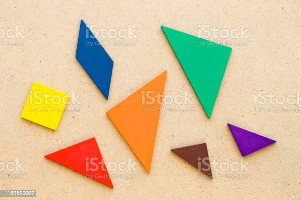 Color tangram in piece wait to complete shape on wood background picture id1132520027?b=1&k=6&m=1132520027&s=612x612&h= elefdp3f4keify6xhhnbfwkpuqbzmwch1w lwcu7m0=