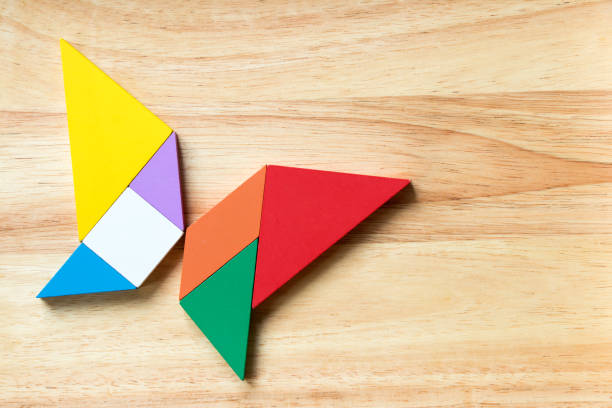 Color tangram puzzle in flying butterfly shape on wood background picture id900857298?b=1&k=6&m=900857298&s=612x612&w=0&h=ns4fblfasfzj0dcgxvsgwthozvroarkmb1hm0mnyntc=