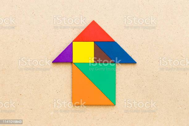 Color tangram puzzle in home or arrow shape on wood background picture id1141015843?b=1&k=6&m=1141015843&s=612x612&h=g2pwyicjqm8vxk1msw6txfdcmrllq29tgkfcolde dw=