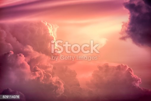 529114076 istock photo Color toned image,Dramatic sunset sky with colorful clouds. 529114076