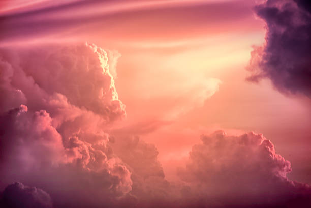 Color toned image,Dramatic sunset sky with colorful clouds. Colorful clouds on the dramatic sunset sky, Color toned image,Dramatic sunset sky with colorful clouds. atmospheric mood stock pictures, royalty-free photos & images