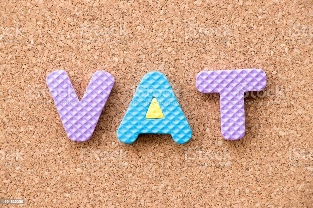 Color toy foam alphabet in word VAT (Abberviation of Value added tax) on cork board background royalty-free stock photo