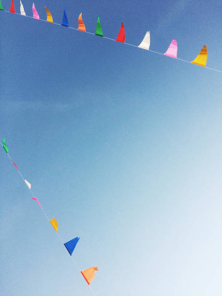 color triangles flags in the sky - school fete stock photos and pictures