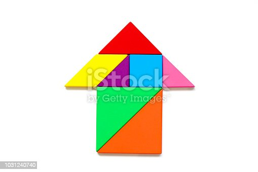 istock Color wood tangram puzzle in arrow shape on white background 1031240740