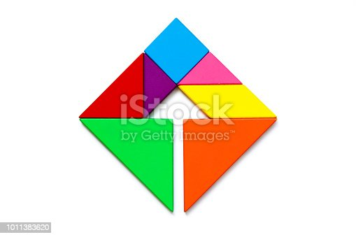 istock Color wood tangram puzzle in square with arrow inside shape on white background 1011383620