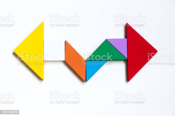 Color wood tangram puzzle on direction arrow shape in the opposite picture id870183702?b=1&k=6&m=870183702&s=612x612&h=hbt7w ql1fvx45nwbl3yi0lm5lqbh fyy7abnfx1l4i=